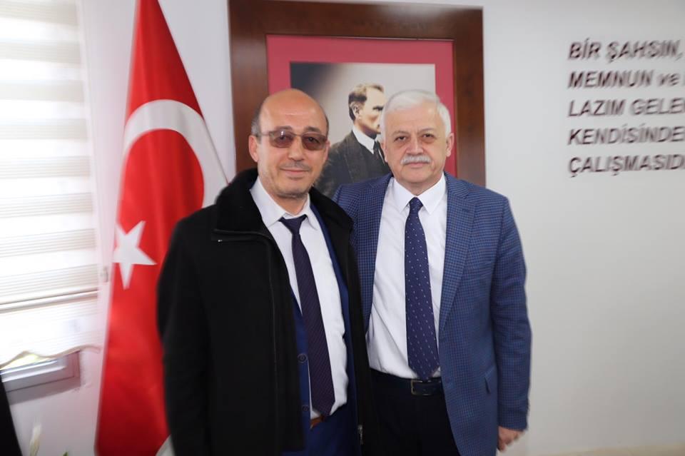 Burhaniye Bağımsız Belediye Başkan Adayı Nuri Bayraktar Burhaniye Belediye Başkanı Ali Kemal Deveciler'i Ziyaret Etti